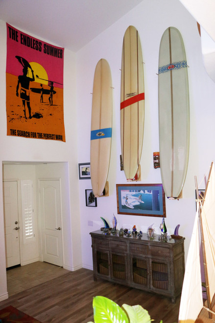 3 surfboards on vertical wall rack