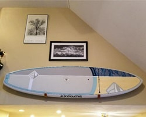 paddle board mounted above stairwell