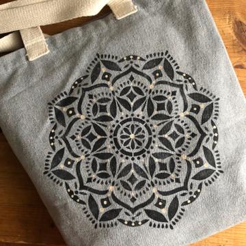 Karma Manadala Stencil on a Canvas Bag