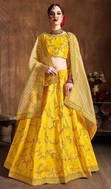 Lehenga Choli in Yellow Color Embroidered Silk