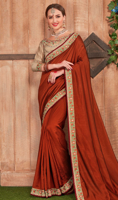 Fancy Fabric Embroidered Saree in Redish Maroon Color