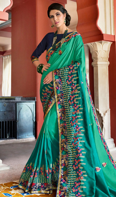 Rangoli Fabric Embroidered Sari in Green Color