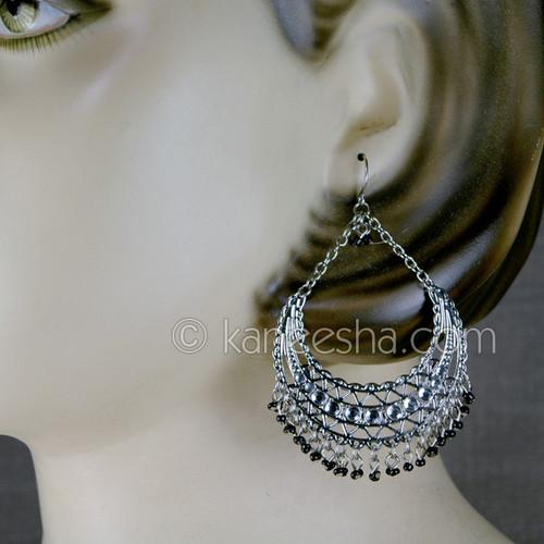 Silver hoop earrings. Pierced.