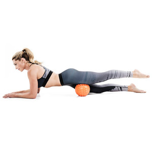 Bionic Body Massage Ball used by Kim Lyons to massage and rest hamstrings