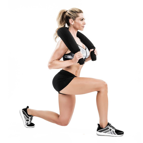 Kim Lyons using the Bionic Body Shoulder Bag to create more resistance for her lunges