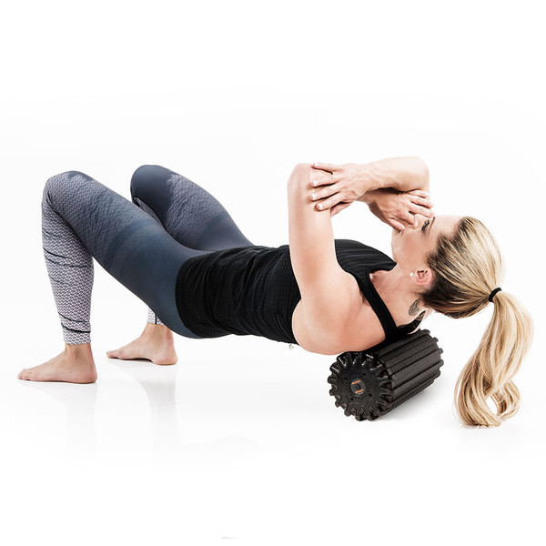 Kim Lyons using the Bionic Body Rechargeable Vibrating Recovery Foam Roller Massager - BBVYP for after workout back recovery