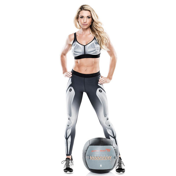 Kim Lyons standing with the Bionic Body 6 Lbs. Medicine Ball