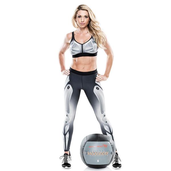 Kim Lyons standing with the Bionic Body 6 Lbs. Medicine Ball