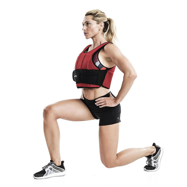 Kim Lyons using the Bionic Body 15lb Weighted Vest to add resistance to her lunges