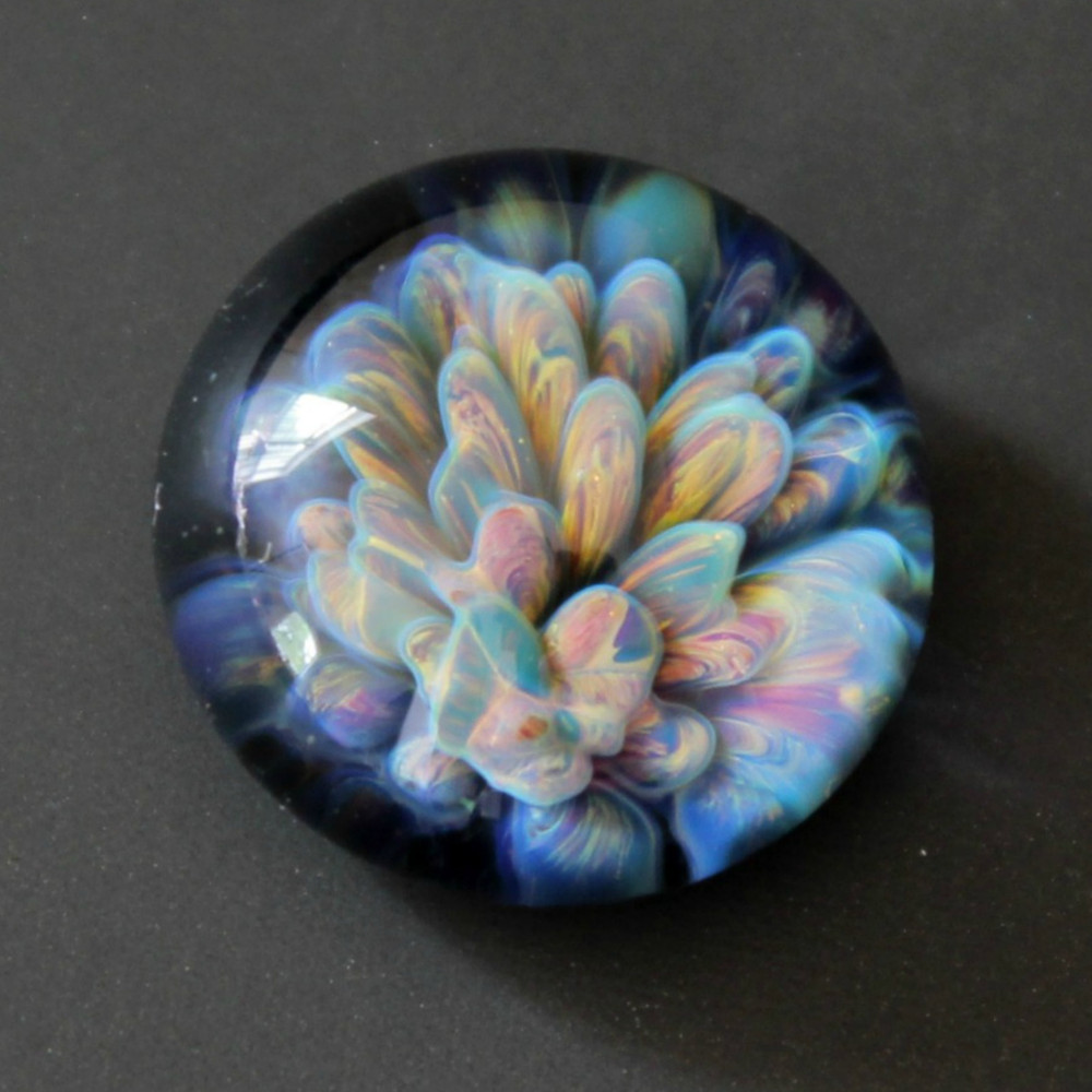 Glass textured cabochon in hues of gold, purple , green and blue