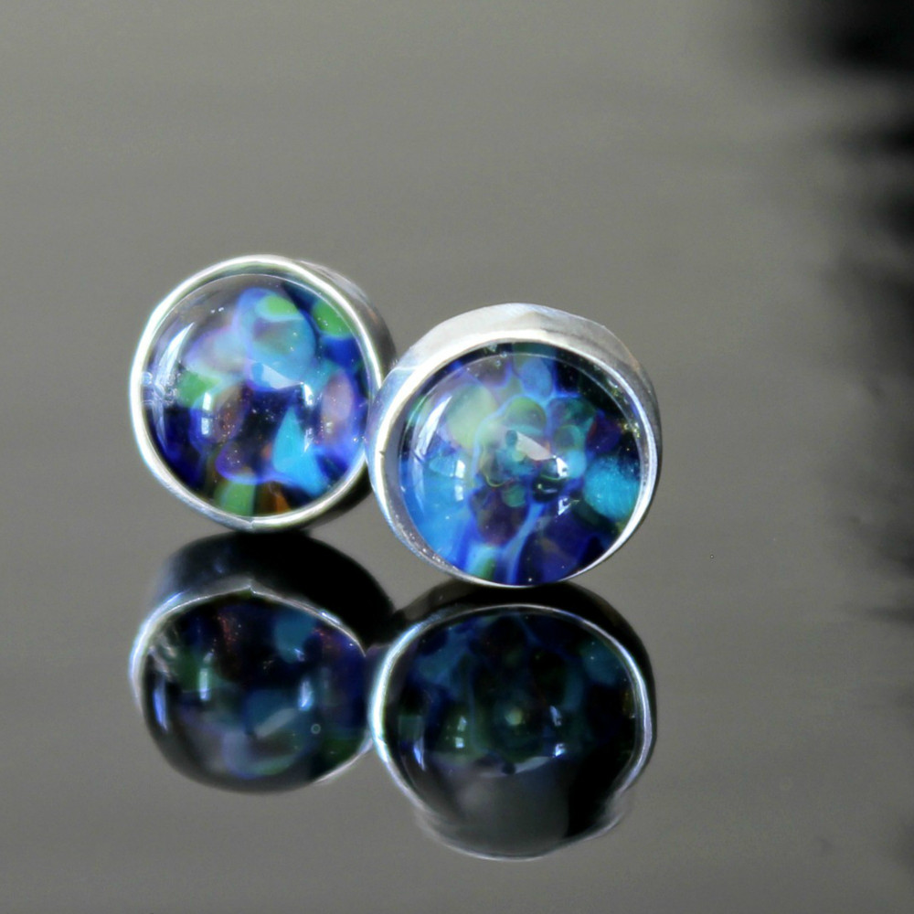 Gorgeous garden party colors of blue, green & purple set in 10mm glass cabochons with a .925 sterling silver bezel and post.