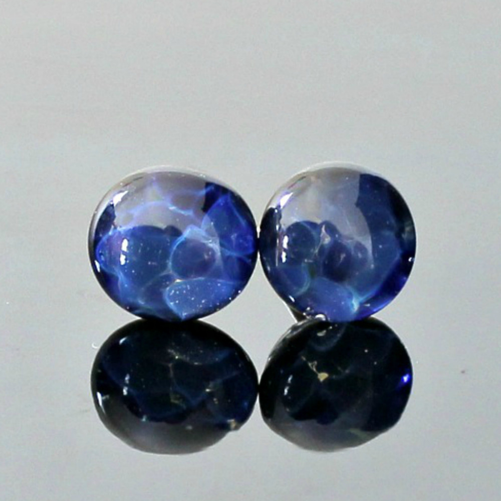 Beautiful blue glass stud earrings. They look like oceans of color hues  Made from Boro Lampwork Glass