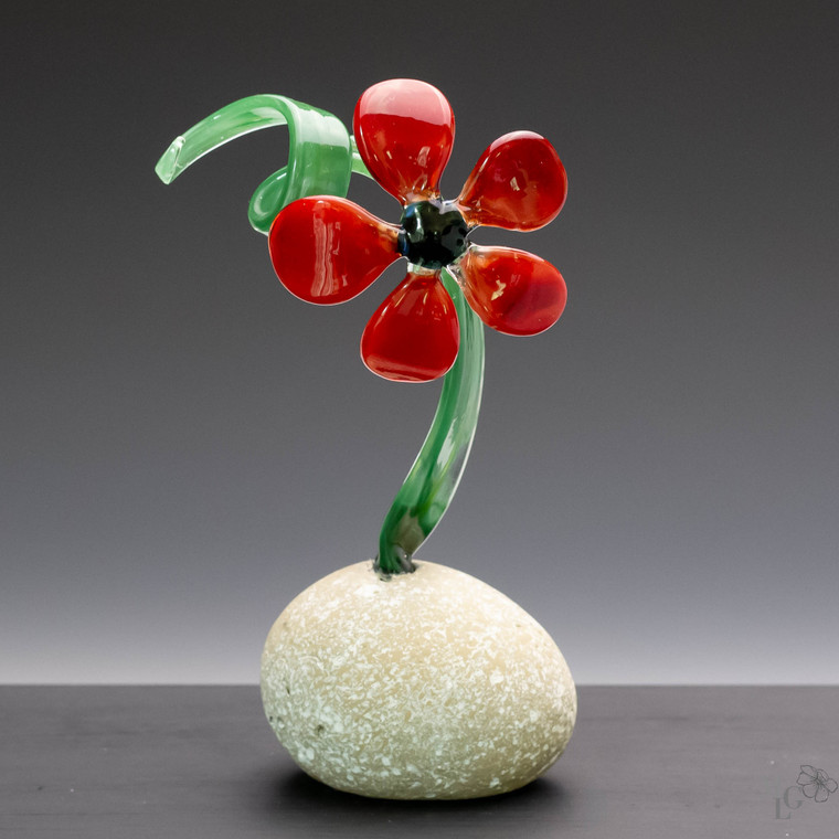 Vibrant and colorful this cherry red glass flower is full of life!  I think this is the most perfect red! With the addition of the hippy green leaf and the black of the faux rock base and it's a winning combination
