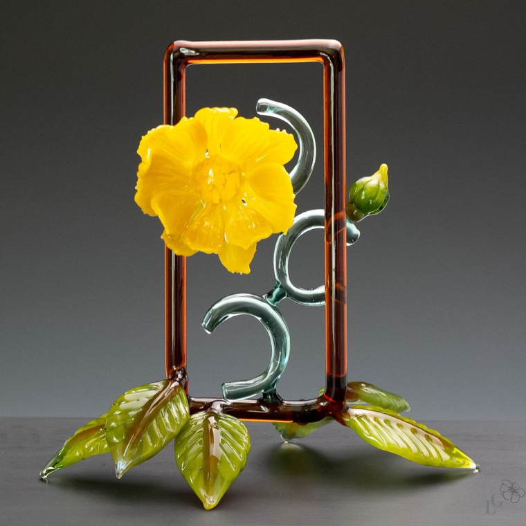 Entangled is a subdued yellow glass flower sculpture created in a contemporary design
