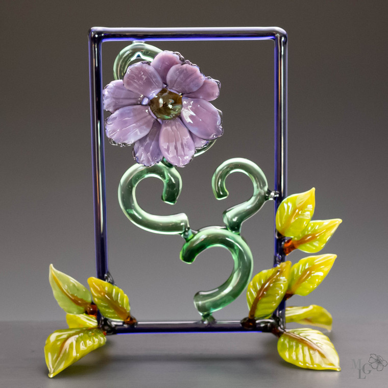 Brilliant colored glass wildflower framed in contrasting green. Just breath in the beauty, calm, sparkling feel of this unique contemporary sculpture