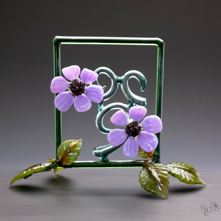 Arise: double purple glass flowers in an organic green frame with leaves around