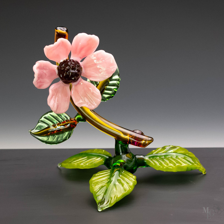 Flamework art glass wildflower in a soft pink color. This table top botanical sculpture looks fresh from the garden