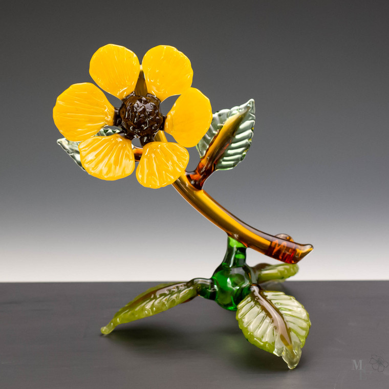 Bright summertime sunshine yellow glass wildflower. This one of a kind sculpture bring a fresh garden feel with a lot of sparkle to any room in your house