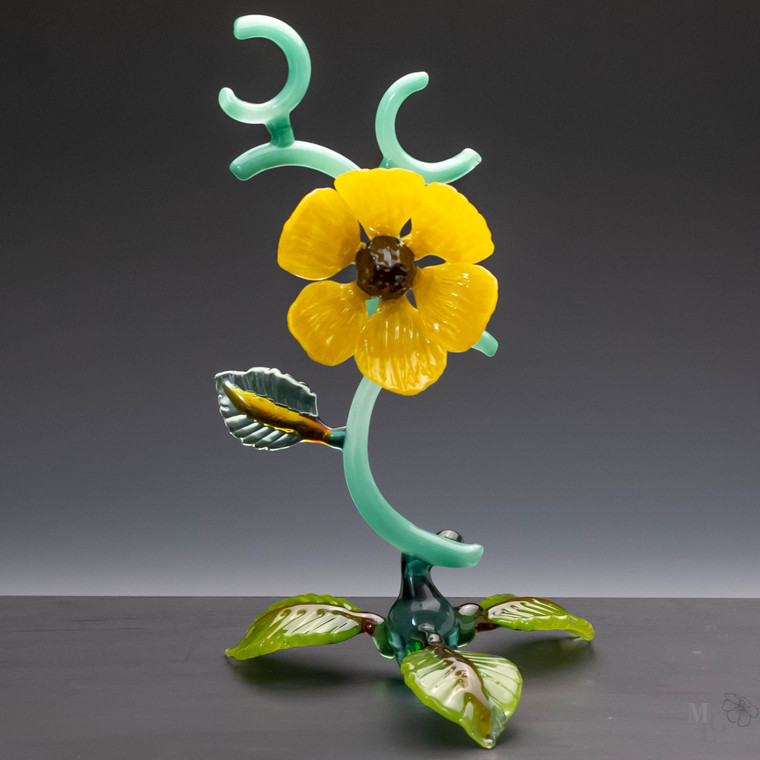 Radiant yellow glass wildflower sculpture in a contemporary style