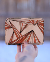 Outside leather card holder with ray pattern