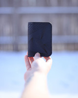 front black leather card holder with ray pattern