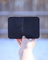outside black leather card holder with ray pattern