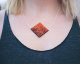 Leather flower etched necklace