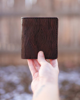 Leather wallet with engraved wood grain
