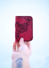 Leather card holder oxblood with cherry blossoms front