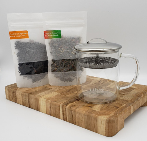 Contents: (2) 1 oz. bags of loose leaf, locally-crafted teas, 1 glass ethoz brewer