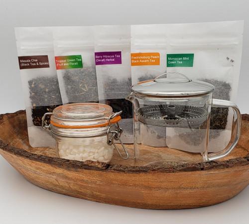 (5) 1 oz. bags of loose leaf, locally-crafted teas, 1 jar of Belgian pearl sugars, 1 glass ethoz brewer