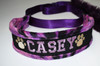 Padded martingale dog collar with embroidered name and paw prints.