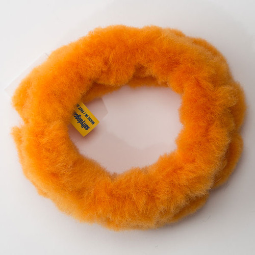 Circular dog tug toy made of non-toxic sheep shearling fur.