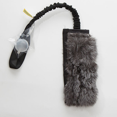Real rabbit stick fur dog tug with reinforced mesh and squeakers.