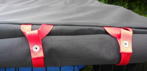 Zippered door flap held with webbing ties and dome fasteners.