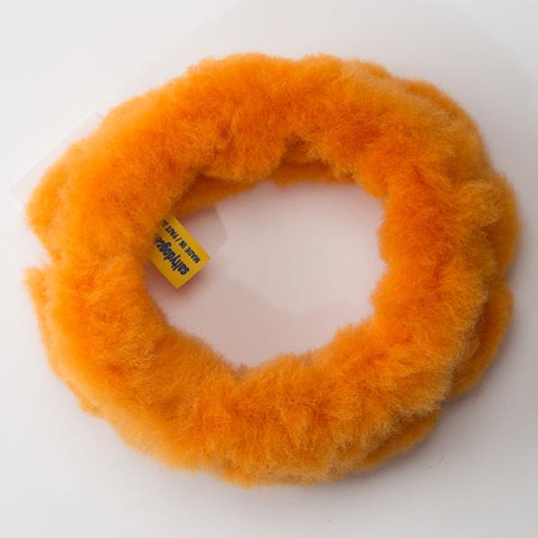 Circular dog tug toy made of non-toxic sheep shearling fur.
