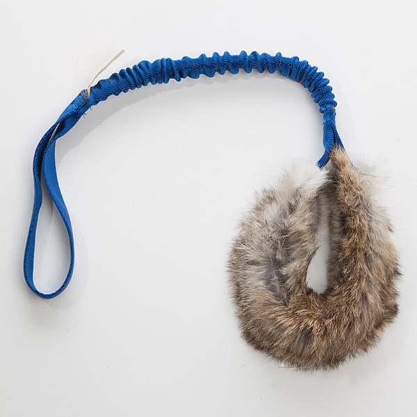 Real rabbit fur dog tug toy for agility or flyball.