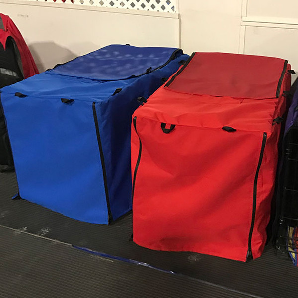 Polyester crate covers with back flap open for ventilation.