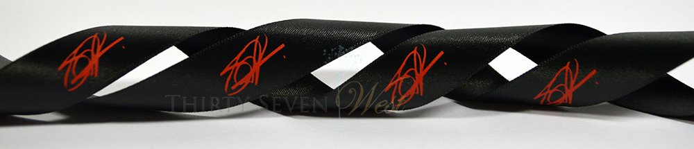 Custom Ribbon with Pantone Matched logo - Matte Red print on black satin ribbon