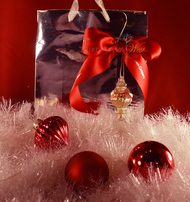 Custom logo ribbon and an ornament make a great gift bag idea.