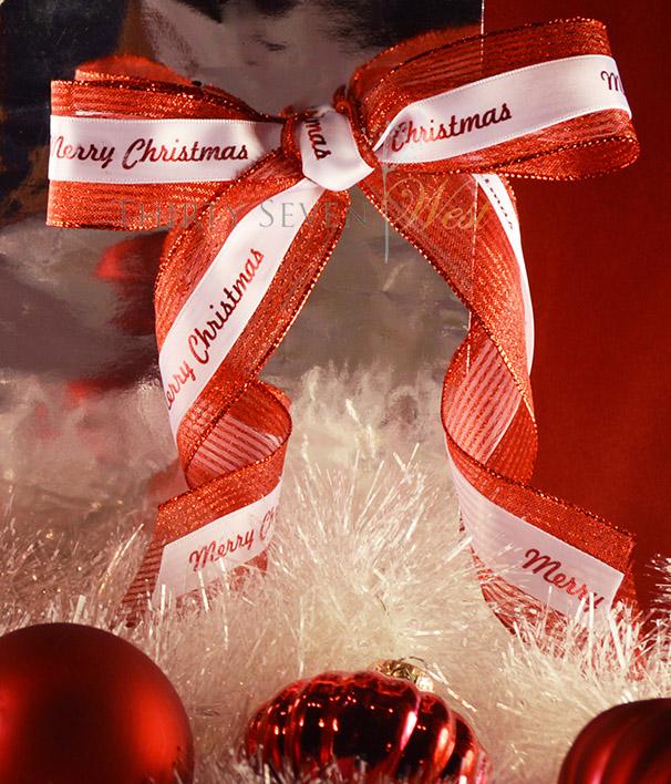 Red and White Custom Printed Holiday Ribbon.   Holiday ribbon, Event Ribbon, Custom Logo Ribbon, Company incentive ribbon. Company branding.