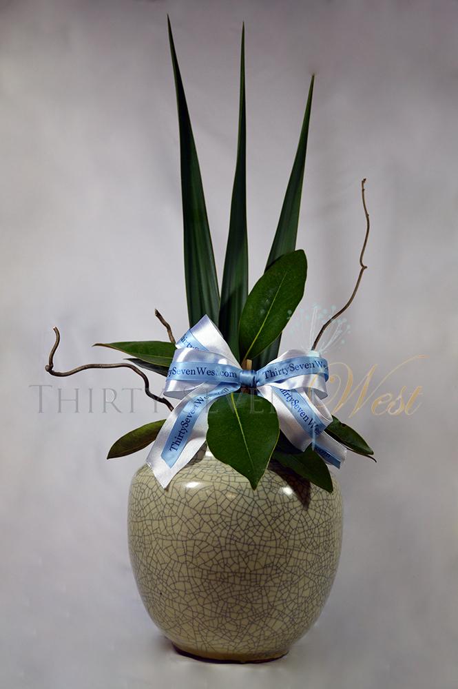 Simple, stunning, and elegant event decor.   Economical idea, too! custom printed ribbon with logo, wire edge ribbon with logo, navy blue company name printed on light blue ribbon, white wire edge ribbon with printed ribbon on it.