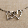 """""""Opposites Attract"""" Double Heart Link Necklace"""