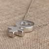 The pendant thickness is not too much, and not too little!  This pendant has a nice weight to it.