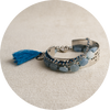 Shown together but sold separately! CURATED: CLEAR RHINESTONE BRACELET WITH TURQUOISE STRING ACCENT, JANET JEWELRY AQUAMARINE AND BLUE TOURMALINE BRACELET, and JANETJEWELRY CUFF BRACELET.