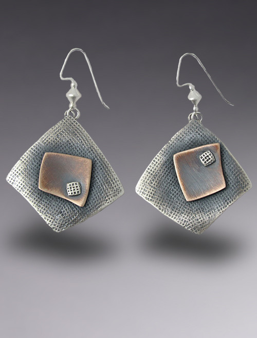 Pair of sterling silver with bronze details