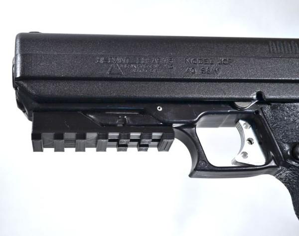 Hi Point large 40 caliber pistol, epoxy on lower picatinny rail