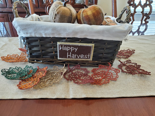 Lace leaves displayed with a basket of pumpkins