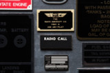 Brass Waco placard, screen printed glowing RADIO CALL phenolic placard, and North American Aviation 5P16 hydraulic placard - note incredible detail of etch and fill.