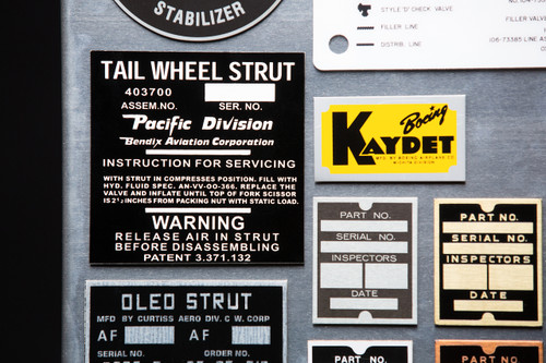Boeing Kaydet placard, variants of a 5P1 North American placard and etched P-40 tailwheel placard.